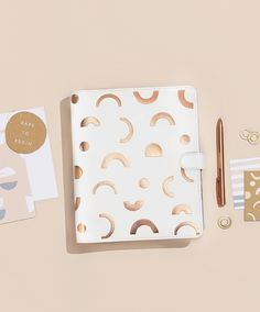 Escape the Ordinary with this beautiful white and copper planner
