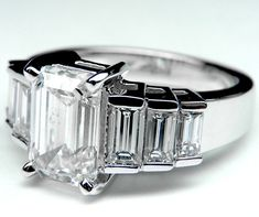 Emerald Cut Diamond Engagement Ring With Step Up Baguettes
