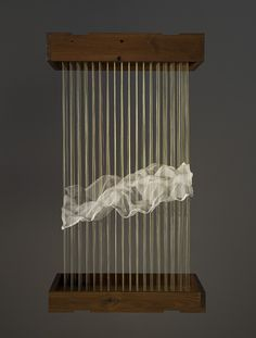 "Maggie Casey: Model: Cloud THREAD, SILK ORGANZA, COPPER TACKS, WOOD. 18"" x 12"" x 30"" 2006"