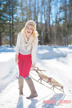 Morgan Werner Senior Photography | Senior in the Snow with a sled