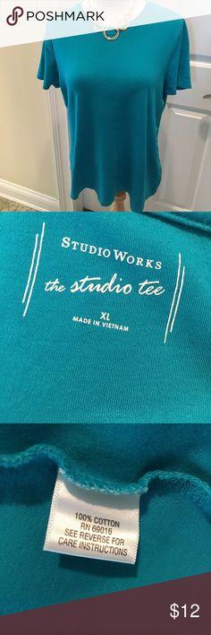 Nearly New Short Sleeved Cotton Tee Shirt 👚 EUC Nearly New Short Sleeved cotton tee shirt with a round neckline.  Pretty deep aqua color.  No fading.  EUC. Nonsmoking house. Studio Works Tops Tees - Short Sleeve