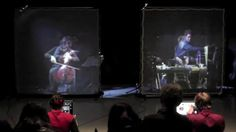 """""""Generation Kill - offspring 1"""" (Stefan Prins, 2012) by Stefan Prins. For cello, percussion, two musicians with game controllers, live-video and live-electronics. Live performed by Nadar Ensemble (Pieter Matthynssens, vc; Yves Goemaere, perc; Elisa Medinilla & Dries Tack, game controllers; Stefan Prins, sound) at """"Open Music"""" concert series, Forum Stadtpark, Graz on 12th of January 2013."""