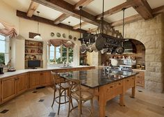 French Provincial style kitchen is ideal for whipping up a batch of breakfast crepes on a sunny weekend morning. #granitecounter #woodbeams #potrack