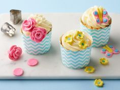 Food Network Kitchen's homemade two-ingredient marshmallow fondant tastes delicious and is super fun for crafty dessert decorators. You can make a cute cupcake garden with these designs — but the sky's the limit on your creativity!