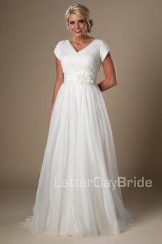 ffd9f3a13814b V-neckline with ruched silky organza and a wide waistband with flowers at  the natural