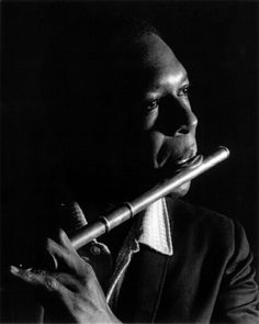 Pictured above is John Coltrane playing the flute. Eric Dolphy's mother gave Coltrane his instruments shortly after Dolphy died. Coltrane later on played the flute and bass clarinet in honor of Dolphy. You can hear Coltrane playing the bass clarinet on his Live in Japan album.