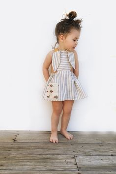 This bunny apron is a favorite in our house! This open back apron features floppy bunny ears lined with a vintage inspired floral and an oversized pocket. Mustard yellow straps cross in the back for a