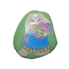 A medium-sized Colorado rock features a cute bunny caressing a heart painted on one side and a plaid heart on the reverse side.