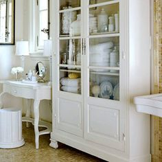 Beautiful white bathroom. Turn a child's writing desk into a vanity for the master bathroom. #bathroom #vanity #storage
