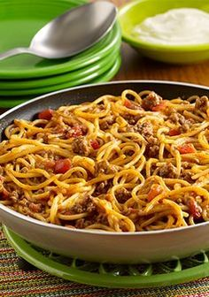 Can't decide between tacos or spaghetti for dinner tonight? You don't have to when you make this Taco Spaghetti Skillet recipe!