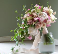 BOUQUET STYLE: hand-tied tear drop cascade of ivory peonies, peach spray rose, lisianthus, ....