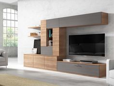 This wall unit is the perfect example of how wood grain and matt finishes are being used in combination to give a chic. Living Room Wall Units, Living Room Tv Unit Designs, Living Room Decor, Tv Cabinet Design, Tv Wall Design, House Design, Living Room Lighting Design, Tv Wall Cabinets, Tv Unit Furniture