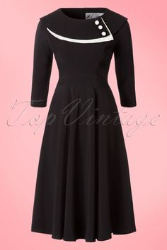 40s Sonia Dress in Black and Ivory Crêpe - Das40s Sonia Dress in Black and Ivory CrêpevonBunny ist ein klassisches Kleid mit verspielten Details!Klassisch, verspielt und zeitlos.... dieses Kleid wirst du nicht bereuen! Mit einem figurbetonenden Top mit einer runden, hochgeschlossenen Halslinie, einem eleganten, doppelten Kragen in Schwarz und Ivory (Elfenbein) der mit 3 Stoffknöpfchen geschmückt ist. Mit 3/4 Ärmeln versehen. Ab Taille hat das Klei...