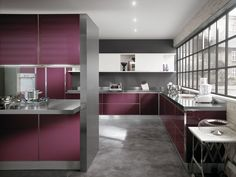 """Scenery. Design King & Miranda. The island, with """"Mirage"""" system, links the service zone to the living area, which is not at all cut off by the backdrops and ambiences of the Scenery kitchen, a stage of genuine beauty. The doors are in unusual colours (Plum for the gloss coloured glass doors, and Light Grey for the gloss lacquered doors used on some wall units). #Living #Scenery #King #kitchen #Scavolini  - See more at: http://www.scavolini.us/kitchens/Scenery"""