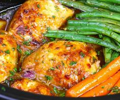 This photo is a closeup of honey garlic chicken in a slow cooker crock pot with carrots, green beans and potatoes after cooking ready to serve