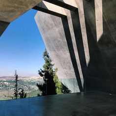 Lights and shadows on the balcony upon exiting Yad Vashem's Holocaust History Museum. Architect: Moshe Safdie.