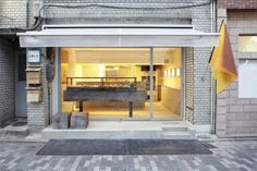 Panscape bakery in Kyoto is a perfectly minimal designed bakery, included on the floor is a back lite mouse hole..