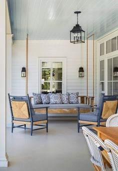 "A Charleston porch. The blue ceiling is a tradition that "" keeps evil spirits away from one's door"" !"