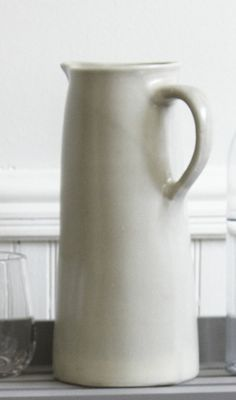 i bought two jugs (look like this) at Pottery Barn and use for serving (milk or half 'n half for hot bevies) often