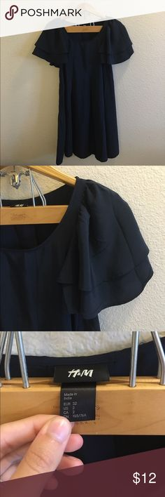 H&M Navy Dress Size 2 H&M navy blue dress with ruffled sleeves and flowy bottom. Open to any offers; bundles discounted! H&M Dresses Mini