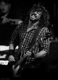 Dave Grohl  <3. This is one guy who's enjoying his life!
