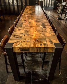 Mosaic Table, designed by Stacklab, made from offcut pieces of upcycled Hemlock wood salvaged from underground near the Toronto waterfront. Georgous!