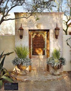 Hammered door, pea gravel, rusty planter, lanterns.....