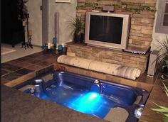 DIY - Hidden hot tub under floor. Cool idea... curious what the structure of the house holds up down the road and what impact the humidity has.