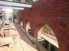 Cutting bricks to archway