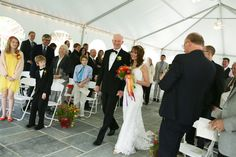 Seneca Lodge wedding with a tented outdoor ceremony.  Jon Fleming Photography.