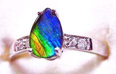 Ammolite Pear Ring Sterling Silver 52SR$159.99#ammolite #korite #ammonite #fengshui #canada #canadagems #canadianammolite #gemstones #jewelry #jewelryaddict #photooftheday #jewelryoftheday #jewelrygram #colorful #gem #gems #opal #minerals #natureinspired #rainbow #alberta #fossil #Alaska #followersofinstagram #isellrocks #art #handmade #lapidary #madeinmontana #ammolite #ammolitestone Turquoise Bracelet, Sterling Silver Rings, Pear Ring, Ammonite, Pear Shaped, Fossil, Bracelets, Minerals, Opal