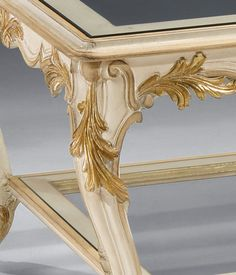 Louis XVI style carved wood coffee table in antique white finish and antique gold-leaf accents with clear glass top and shelf | coffee tables | wrought iron tables
