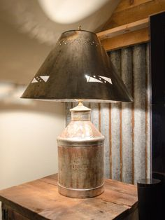 A vintage milk jug becomes the base for a punched-tin table lamp.