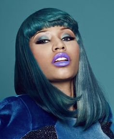if you want a head-turner extraordinary look, you can imitate Nicki Minaj in her purple lipstick, black eyeliner and teal eyeshadow and hair.