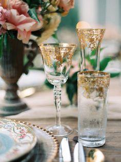 gold glassware - photo by Nicole Berrett Photography http://ruffledblog.com/chic-texas-garden-wedding