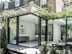 Kitchen extension design with glass sliding doors creates light filled family kitchen glass box. Charles Barclay Architects Kitchen extension design with glass sliding doors creates light filled family kitchen glass box. Orangerie Extension, Extension Veranda, Glass Extension, Rear Extension, Extension Google, Door Design, Exterior Design, House Design, Garden Design
