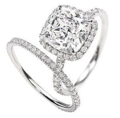 Perfection... Cushion cut with halo and Diamond Band.