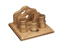 The napkin holder with apple designincludesa salt and pepper shaker and toothpick holder.