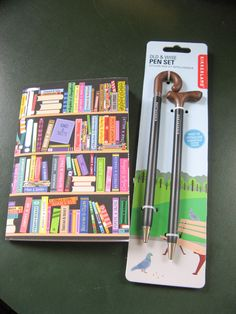 Susan Says: Old & Wise Pen set - two styles of canes, twist and pesto... it's a pen. Over-the-Hill Cool - Grams and Gramps will approve. Pair it with the bookshelf notebook - it's soft covered, very colourful, lined pages, a dynamic-duo opportunity.  Available at Best of Friends Gift Shop in the lobby of Winnipeg's Millennium Library. 204-947-0110 info@friendswpl.ca Lined Page, Pen Sets, Canes, Gifts For Friends, Pesto, Opportunity, Notebook, Writing, Shop