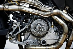 What else could it be? Booming exhaust, bag of spanners clutch and bolts made of cheese.
