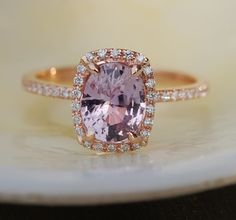Rose gold sapphire ring. Lavender lilac sapphire ring. The sapphire is awesome! Natural sapphire,mauve color, 1.83ct, eye clean, cushion cut, unheated.  The setting is 14k rose gold, TDW approx.0.2ct, SI/H.  This ring is ready to ship. USPS priority to the US takes 2-3 business days. DHL to Europe takes 3-5 business days. Shipping within Canada takes 1-3 business days. If you need sizing, please add 2-3 business days.   Matching diamond is available and can be ordered separately…