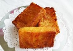 Cassava Pone African Caribbean dessert/cake made with cassava, coconut and pumpkin. Slightly chewy mouth feel. Major yum. Made by & sold at Alima's Roti and Pastry 13 Kenview Blvd Brampton ONT Canada 905 791 7684