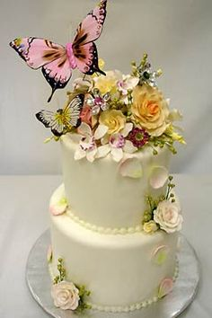 Butterfly and flowers cake. I kind of like the arrangement--simple at the bottom, super busy at the top, but a simple butterfly sticking out on top of that.