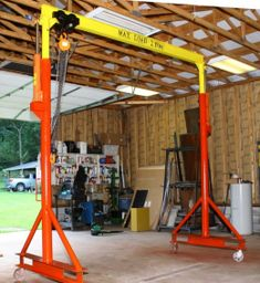 Adjustable Gantry - Homemade adjustable gantry constructed from pipe, steel plate, hydraulic cylinders, a winch, and casters.