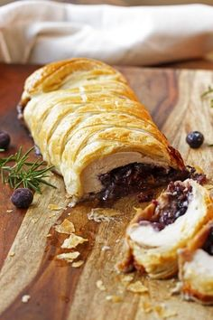 "Recipe by Julie Kinch & Debbie Fraser, ""Cooks with Cocktails"" Blog   This savory Blueberry & Brie Turkey Wellington is the perfect showpiece for your seasonal meals.  Warm, melted cheese and crumbly bacon combined with fresh herbs, blueberries and airy puff pastries will make Blueberry & Brie Turkey Wellington your new favorite dish."