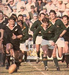 '76 - First test - The McLook rugby collection Jan Ellis and Ken Stewart chasing after the ball. Ellis was outplayed at the breakdowns and looked just a bit tentative with the ball in the hand not taking it to the All Blacks and it was no surprise when he was replaced by Theuns Stofberg for the second test.