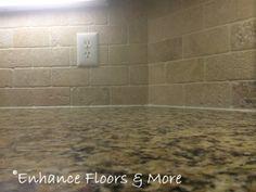 New Venetian Gold granite countertop with tumblestone backsplash