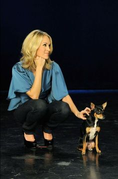 Carrie Underwood with her pet   | celebs | | pets |  #celebswithdogs #celebswholovedogs   https://biopop.com/