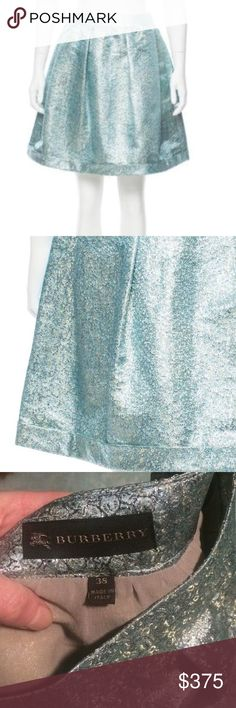 """Burberry metallic a line blue cocktail skirt 2 In excellent condition. A few loose threads at LINING not exterior (see photos). Waist about 24-25"""", about 19"""" long. Authentic. Designer size 38, similar to US 2. Burberry Skirts Mini"""