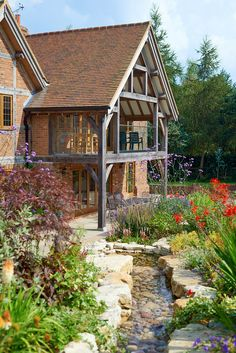 Thoughtful landscaping surrounds the exposed oak framed building.